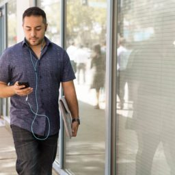 Man walking while looking at cellphone